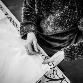 Seamstress hand stitching